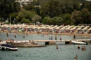 Crowded beaches near Athens, after they were allowed to open on Saturday, when temperatures hit 38C.  By Angelos Tzortzinis (AFP)