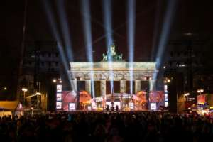 Crowds gathered early in front of a stage erected in front of Berlin's landmark the Brandenburg Gate, ahead of a New Year's party.  By Monika Skolimowska (dpa/AFP)