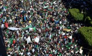 Crowds of demonstrators flooded the streets of the Algerian capital for the fourth consecutive Friday.  By RYAD KRAMDI (AFP)