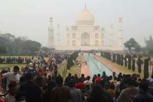 Crowds throng at the Taj Mahal over the weekend as India fights rising coronavirus infections.  By Pawan SHARMA (AFP)