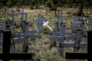 Crosses are planted on a hillside at the White Cross Monument, each one marking a white farmer killed in a farm murder in Ysterberg.  By GULSHAN KHAN (AFP/File)