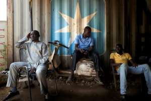 Customers wait to have their Vespa repaired. The Italian scooter has long been supplanted in Mali by a cheaper, Indonesian-made machine, but its vintage looks are prized by many.  By MICHELE CATTANI (AFP)