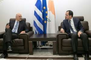 Cypriot Foreign Minister Nikos Christodoulides (R) met with his Greek counterpart Dendias at Larnaca airport near the end of the Greek diplomat's whistle-stop tour.  By Stavros IOANNIDES (PIO/AFP)