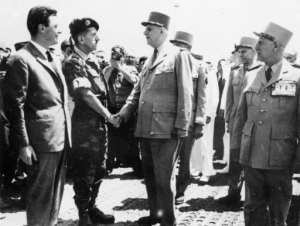 Dangerous game: French President General Charles de Gaulle (C) shakes hands with coup leader General Jacques Massu upon his arrival in Algiers in June 1958.  By STF (AFP/File)