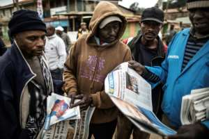 Daily life almost ground to a halt for a third day in the Kenyan capital and elsewhere as the country held its breath for the election results, with memories still fresh of post-poll violence in 2007 that left 1,100 people dead