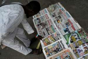 Daily newspapers in Lagos closely follow the ups and downs of Nigeria's February 16 presidential and legislative elections in what is expected to be a close race.  By STEFAN HEUNIS (AFP)