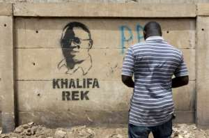 Dakar Mayor Khalifa Sall's five-year term for fraudulent use of public funds has been upheld by a Senegalese court. This graffiti image of the highly popular figure bears the words 'Khalifa Rek' - 'Only Khalifa'.  By SEYLLOU (AFP/File)