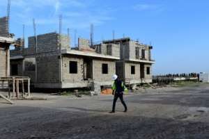 Dakar's development is constricted by its position on a headland. A massive project is under way to build a new city 40 kms in Diamniadio -- but few people have moved there.  By Seyllou (AFP)