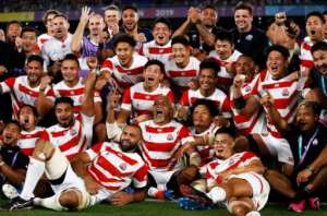 Day to remember: Japan's players celebrate beating Scotland.  By Odd ANDERSEN (AFP/File)