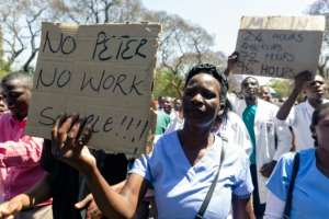 Demonstrator believe Dr Peter Magombeyi was taken because of his role in organising strikes to demand better pay and working conditions.  By Jekesai NJIKIZANA (AFP)
