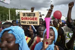 Demonstrators backing the army took to the streets in Malian capital Bamako this week amid wrangling over how to end its military junta.  By MICHELE CATTANI (AFP/File)