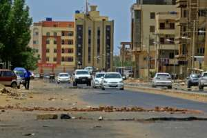 Demonstrators have erected makeshift barricades across streets in Khartoum.  By ASHRAF SHAZLY (AFP)