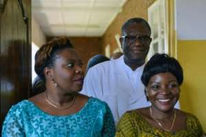Denis Mukwege (back) was in surgery at the Panzi hospital when he heard he had won the Nobel Peace Prize.  By Alain WANDIMOYI (AFP/File)