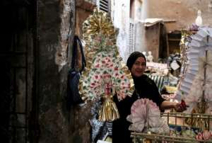 Decorated sugar dolls, horse-shaped candies and nut-filled treats are on display in shops near Islamic Cairo.  By Mohamed el-Shahed, Mohamed el-Shahed (AFP)