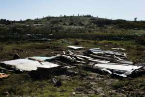 Destroyed: A shack that had been illegally built on a nature reserve outside Cape Town.  By RODGER BOSCH (AFP)