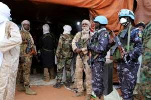 Des soldats togolais de la Minusma sécurisent un congrès du mouvement touareg MSA, à Menaka, au Mali, le 14 mars 2020.  By Souleymane Ag Anara (AFP)