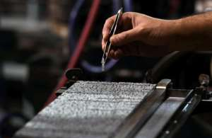 Designers created a font of thousands of hieroglyphs and cast them in lead, so they could be arranged line by line, covered in ink and printed onto paper.  By Ahmad HASSAN (AFP)