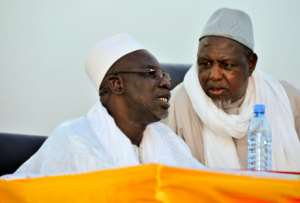 Dicko pictured right in 2015, told the crowd jihadism had no place in Mali.  By HABIBOU KOUYATE (AFP/File)