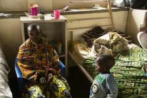 Doctors say that Kavuho Ndovya (L), a mother of five, bears horrific scars and wounds.  By Bienvenu-Marie Bakumanya (AFP)