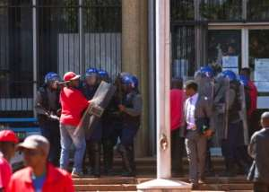 Dozens of police blocked off the site of an opposition rally to demand electoral reforms in Harare