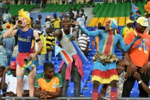 DR Congo supporters cheer for their team during their 2017 Africa Cup of Nations Group C match against Morocco, in Oyem, on January 16
