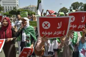 During a Hirak demonstration last year, protesters carried placards saying in Arabic 'No to biased media'.  By RYAD KRAMDI (AFP/File)