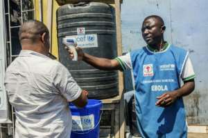 Ebola guidelines include checking temperatures and washing hands.  By Pamela TULIZO (AFP/File)