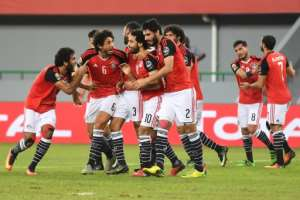 Egypt teammates celebrate after scoring a goal during the 2017 Africa Cup of Nations group D football match against Ghana January 25, 2017