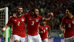 Egypt defenders Baher El-Mohamady (L) celebrates with his Ahmed Elmohamady (C) and Ahmed Hegazi (R) after scoring a goal during the Africa Cup of Nations qualifier football match against Tunisia near Alexandria November 16, 2018.  By KHALED DESOUKI (AFP/File)