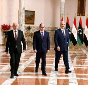 Egyptian President Abdel Fattah al-Sisi (C), Libyan strongman Khalifa Haftar (R) and the Libyan Parliament speaker Aguila Saleh at a joint press conference in Cairo Saturday.  By - (EGYPTIAN PRESIDENCY/AFP)