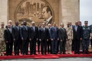 Egyptian President Abdel Fattah al-Sisi poses with ministers during the May inauguration of a tunnel under the Suez Canal, amid accusations from an exiled businessman that millions of Egyptian pounds in public funds have been misappropriated.  By Khaled DESOUKI (AFP/File)