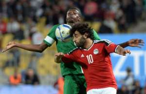 Egypt's Mohamed Saleh (front) and Nigeria's Stanley Amuzie fight for the ball during their African Cup of Nations qualification match, at the Borg el-Arab Stadium in Alexandria, in March 2016.  By Khaled Desouki (AFP/File)