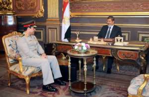Egypt's then president Mohamed Morsi meets then defence minister General Abdel Fattah al-Sissi -- the man who would ultimately topple him.  By - (Egyptian Presidency/AFP/File)
