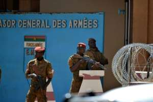 Eight soldiers died in twin attacks on the Burkinabe army headquarters and the French embassy in March.  By Ahmed OUOBA (AFP/File)