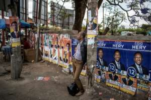 Electoral posters are seen at a bus stop in Antananarivo on November 6, 2018, on the eve of in the first round of the presidential elections.  By MARCO LONGARI (AFP)