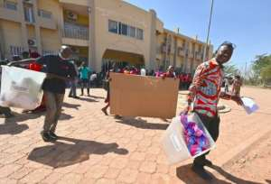 Election workers heading for a polling station in Ouagadougou on Saturday to set up the ballot boxes.  By Issouf SANOGO (AFP)