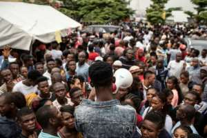 Election call: People in Lagos gathered ahead of polling day to pick up the biometric card entitling them to vote.  By STEFAN HEUNIS (AFP)