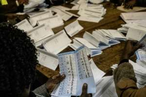 Election officials warn it may take until Saturday for official results to be finalised.  By MARCO LONGARI (AFP)