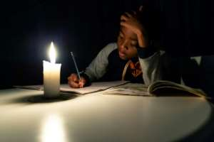 Electricity blackouts - sometimes 18 hours a day -- are just one part of the country's economic crisis.  By Jekesai NJIKIZANA (AFP)