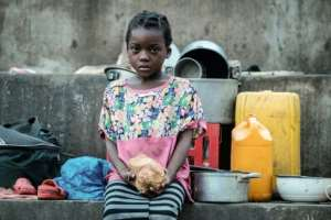 Elena Joaquin, 6, sits in a shelter in Buzi, Mozambique.  By Yasuyoshi CHIBA (AFP)
