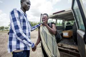 Emmanuel Samuel, 17, comforts his mother, Georgina Pagan after being reunited with her in Aburoc this month. He had been separated from his parents in December 2013 when the civil war in South Sudan had just started