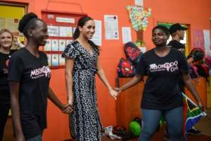 Empowerment: Meghan heaped praise on South African girls fighting mysogeny and violence.  By Courtney AFRICA (POOL/AFP)