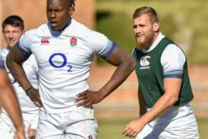 England's winger Brad Shields (R), seen with teammtes during the captain's run at the Saint Stithians College in Johannesburg on June 8, 2018, on the eve of their first Test match against South Africa.  By Christiaan Kotze (AFP/File)