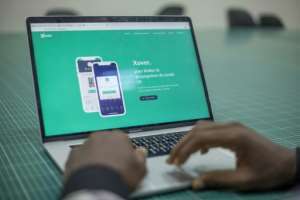 Entrepreneurs at Seme-One have developed X-over, a mobile phone app that makes it possible to trace the chain of contacts made by a person infected with coronavirus.  By Yanick Folly (AFP)