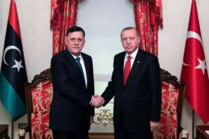 Erdogan and Fayez al-Sarraj of the Tripoli-based Government of National Accord, signed a disputed maritime jurisdiction agreement in November.  By Mustafa Kamaci (TURKISH PRESIDENTIAL PRESS SERVICE/AFP/File)