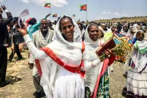 Eritrean women expressing their joy as two land border crossings between Ethiopia and Eritrea were reopened for the first time in 20 years on September 11, 2018.  By Stringer (AFP/File)