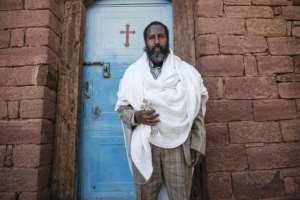 Ethiopian Orthodox priest Kahsu Gebrehiwot says church leaders' failure to speak out may be a sign that they fear for their own lives.  By EDUARDO SOTERAS (AFP)
