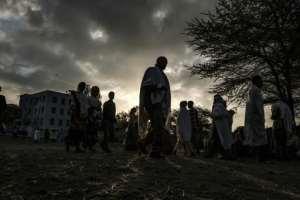 Ethiopian Orthodox worshippers walk towards the Eyesus Church in Alamata.  By EDUARDO SOTERAS (AFP)