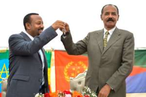 Ethiopian Prime Minister Abiy Ahmed (left) and Eritrean President Isaias Afwerki signed a peace pact in July.  By MICHAEL TEWELDE (AFP/File)