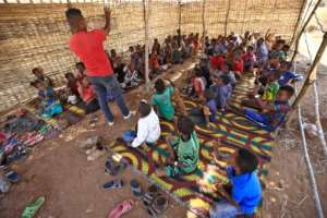 Ethiopian refugee children who fled the Tigray conflict attend classes held by the Norwegian Refugee Council in the Um Raquba camp.  By ASHRAF SHAZLY (AFP)